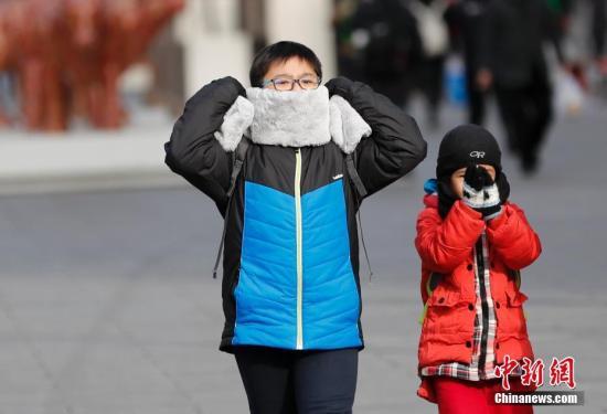 资料图:北京降温 /p中新社记者 杜洋 摄