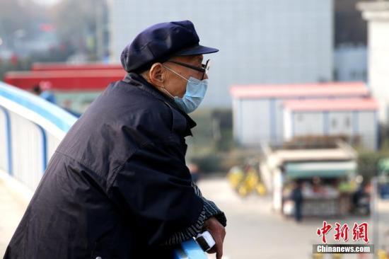 资料图:戴口罩的市民。 中新社记者 张远 摄