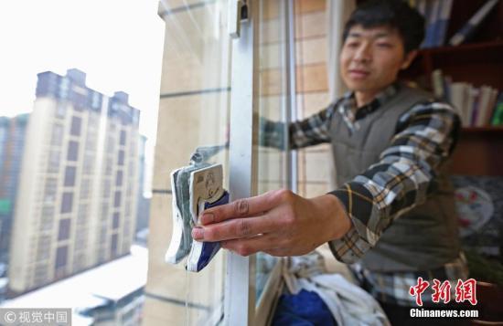 资料图:春节家政服务。 图片来源:视觉中国