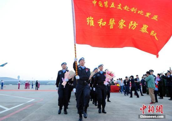 资料图:中国驻利比里亚维和警察防暴队。中新社记者 蒋雪林 摄