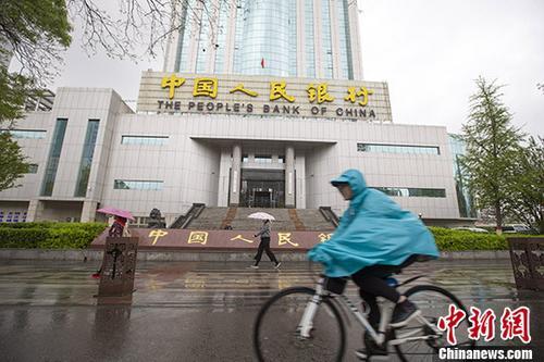 原料图为,民多从中国人民银走太原中央支走前通过。中新社记者 张云 摄