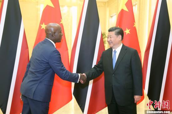5月15日,中国国家主席习近平在北京人民大会堂会见特立尼达和多巴哥总理罗利。<a target='_blank' href='http://www.chinanews.com/'>中新社</a>记者 盛佳鹏 摄