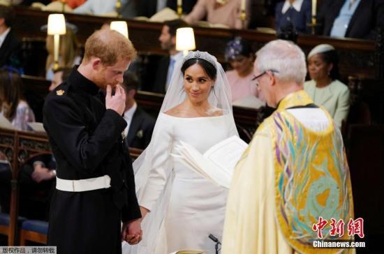 资料图:英国哈里王子与美国女星梅根・马克尔在英国温莎城堡举办婚礼。