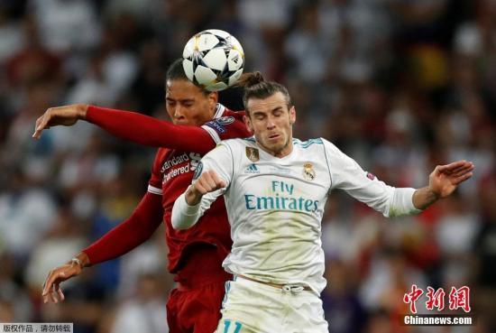 皇马正在上届世俱杯中完成三连冠。材料图:皇马球员贝我(左)正在2018年对阵利物浦欧冠决赛中。