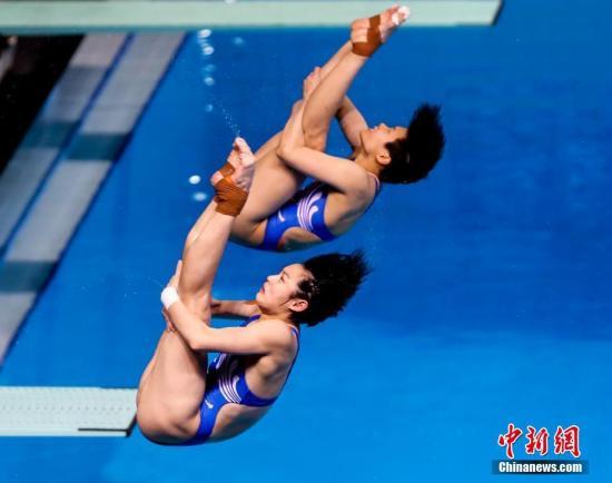资料图:中国队施廷懋/昌雅妮在比赛中。<a target='_blank' href='http://www.chinanews.com/'>中新社</a>记者 张畅 摄