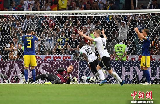 德国队庆祝最后时刻的进球。 <a target='_blank' href='http://www.chinanews.com/'>中新社</a>记者 毛建军 摄