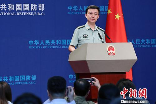 资料图:中国国防部新闻发言人吴谦。中新社记者 宋吉河 摄