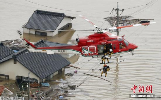 Helicopters are dispatched to rescue people trapped in water in Kurashiki, Okayama Prefecture, Japan, as heavy torrential rains wrecked havoc, July, 8, 2018. (Photo/Agencies)