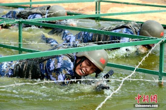 图为中国队员在比赛中。<a target='_blank' href='http://www.chinanews.com/'>中新社</a>记者 王东明 摄