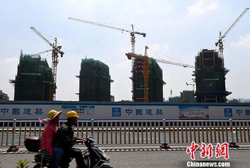 资料图:建设中的房地产楼盘。中新社记者 张斌 摄