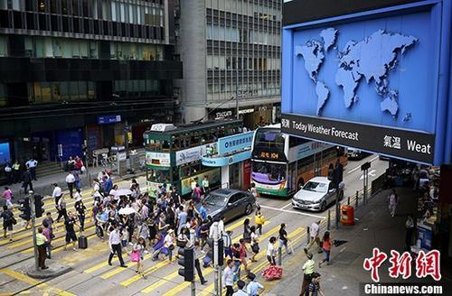 资料图:香港中环街景。中新社记者 张炜 摄