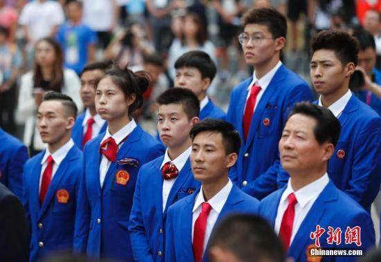 资料图:北京时间8月16日,第18届亚运会中国体育代表团升旗仪式在雅加达亚运村升旗广场举行。 <a target='_blank' href='http://www.chinanews.com/'>中新社</a>记者 杜洋 摄