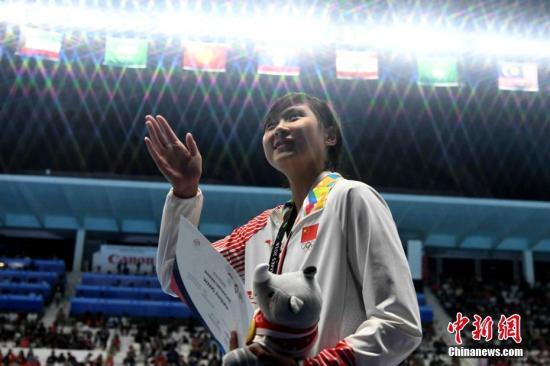 8月24日晚,亚运会游泳女子400米自由泳决赛,中国选手王简嘉禾夺冠。<a target='_blank' href='http://www.chinanews.com/'>中新社</a>记者 王东明 摄