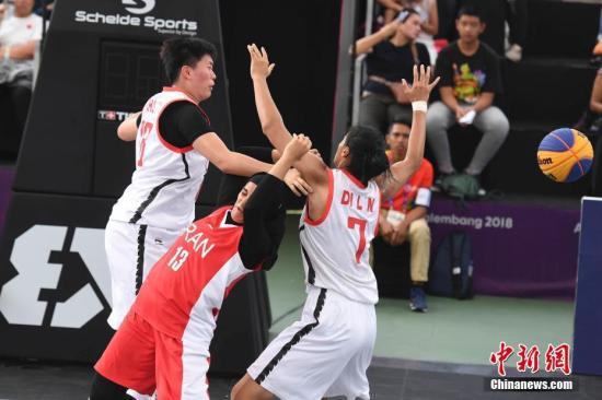 资料图:中国队(白)在亚运会比赛中。<a target='_blank' href='http://LostidoLs.com/'>中新社</a>记者 杨华峰 摄