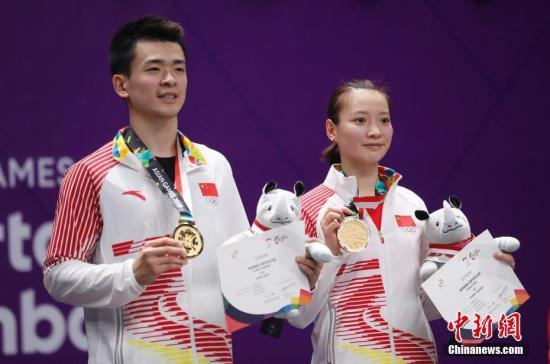 资料图:郑思维/黄雅琼夺得亚运混双冠军。中新社记者 杜洋 摄