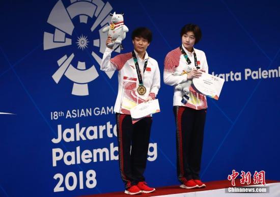 8月29日,在雅加达亚运会女子双人三米板比赛中,中国选手施廷懋、昌雅妮夺得金牌。 <a target='_blank' href='http://www.chinanews.com/'>中新社</a>记者 杜洋 摄