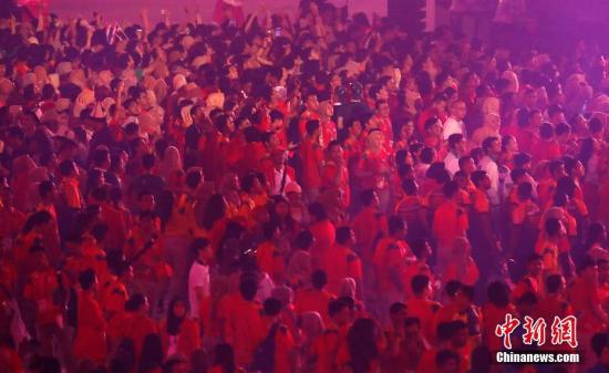资料图:第18届亚运会闭幕式。这届亚运会既有精彩的赛事,也有日本男篮嫖娼这样的丑闻。 <a target='_blank' href='http://www.chinanews.com/'>中新社</a>记者 刘关关 摄