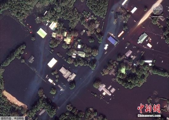 """当地时间2018-12-09,美国北、南卡罗来纳州,飓风""""佛罗伦萨""""袭击当地,造成洪水泛滥,灾后清理工作持续进行。"""