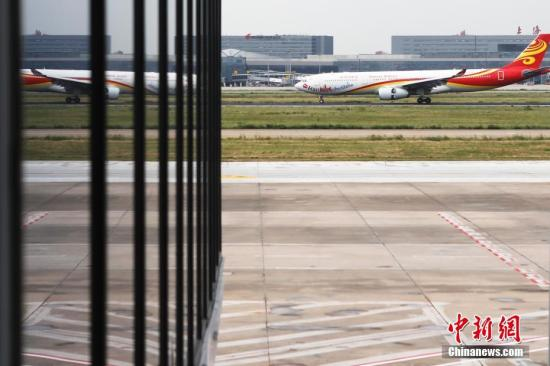 资料图:机场 <a target='_blank' href='http://www-chinanews-com.friendship99.net/'>中新社</a>记者 殷立勤 摄