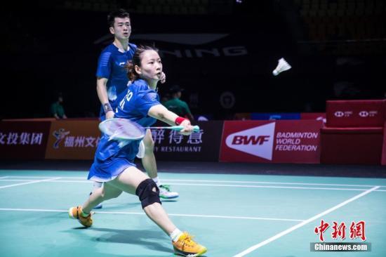 资料图:郑思维/黄雅琼在比赛中。李南轩 摄