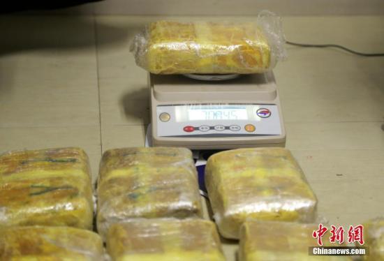 资料图:被警方缴获的毒品。图/刘志坚