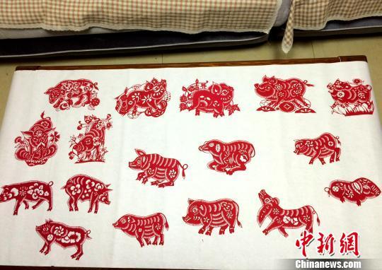 资料图:以猪为题材的剪纸作品。 沙见龙 摄