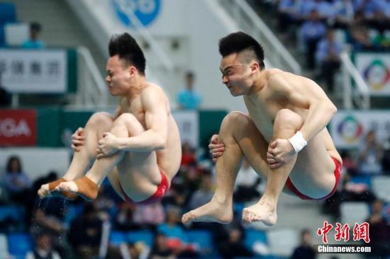 中国选手曹缘/谢思埸在比赛中。(资料图)中新社记者 韩海丹 摄