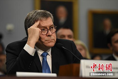 """当地时间4月9日,美国司法部长巴尔在国会众议院出席关于该部新财年预算的听证会时说,删节后的""""通俄门""""报告将于一周内发布。中新社记者 陈孟统 摄"""