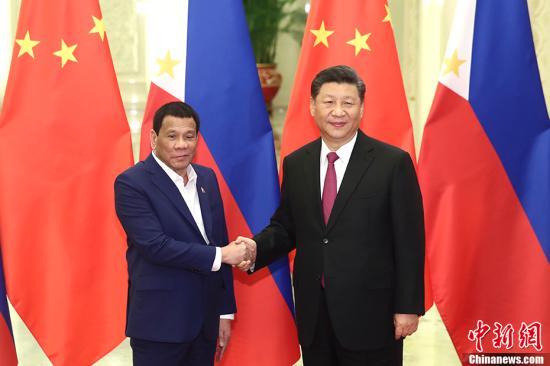 4月25日,中国国家主席习近平在北京人民大会堂会见菲律宾总统杜特尔特。中新社记者 盛佳鹏 摄