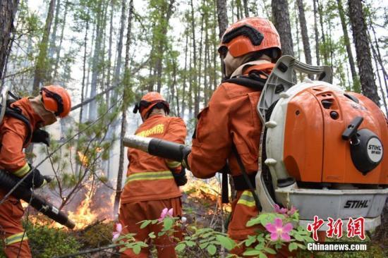 资料图:内蒙古大兴安岭林区森林火灾扑救现场。文/李爱平 供图