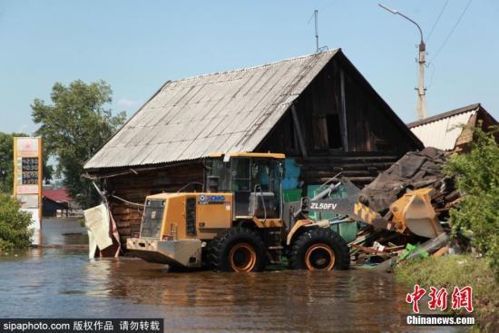 材料图:俄罗斯伊我库茨克州洪灾。 图片滥觞:Sipaphoto 版权做品 制止转载