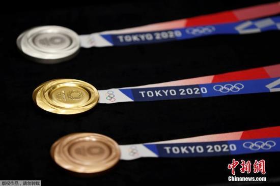 资料图:当地时间7月24日,东京奥运会倒计时一周年,五方印鉴,奥运会奖牌设计在东京国际论坛上揭晓。