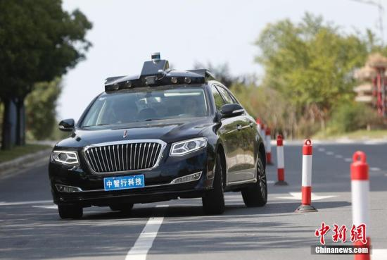 China's first test zone for driverless vehicles with practical applicable scenarios opens in Shanghai