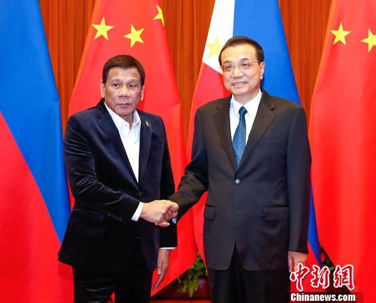 8月30日,中国国务院总理李克强在北京人民大会堂会见菲律宾总统杜特尔特。<a target='_blank' href='http://auctionopia.com/'>中新社</a>记者 刘震 摄