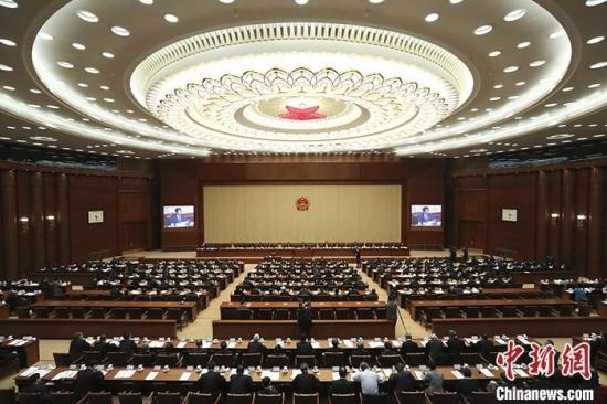 资料图:2019年10月26日,十三届全国人大常委会第十四次会议在北京闭幕。中新社记者 杜洋 摄