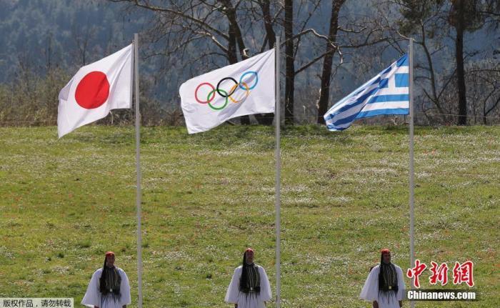 資料圖:東京奧運圣火采集儀式現場。