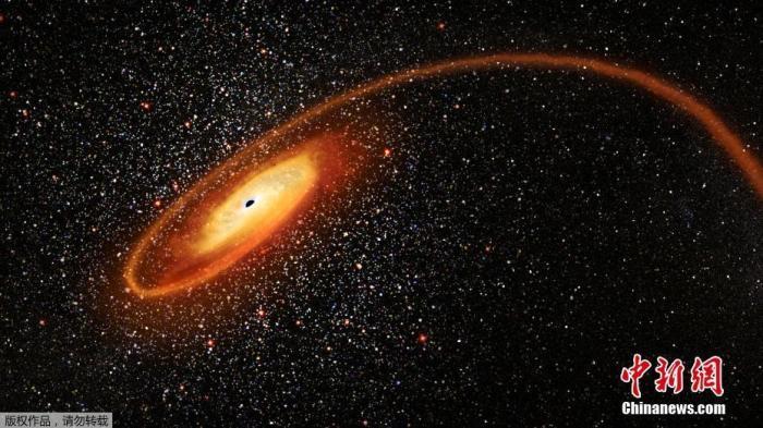 当地时间4月2日,由NASA提供的图片显示了一颗恒星被一个有数万个太阳质量的黑洞撕碎的现场模拟图片,画面壮观瑰丽。