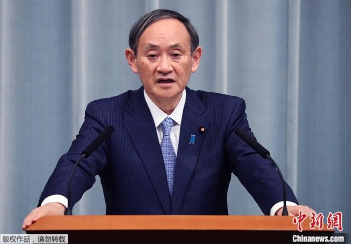 日媒民调:日本首相菅义伟内阁支持率跌至55%图片