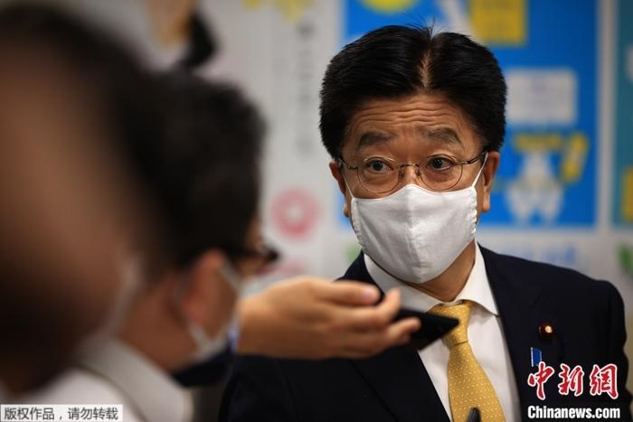 資料圖:日本厚生勞動大臣加藤勝信。