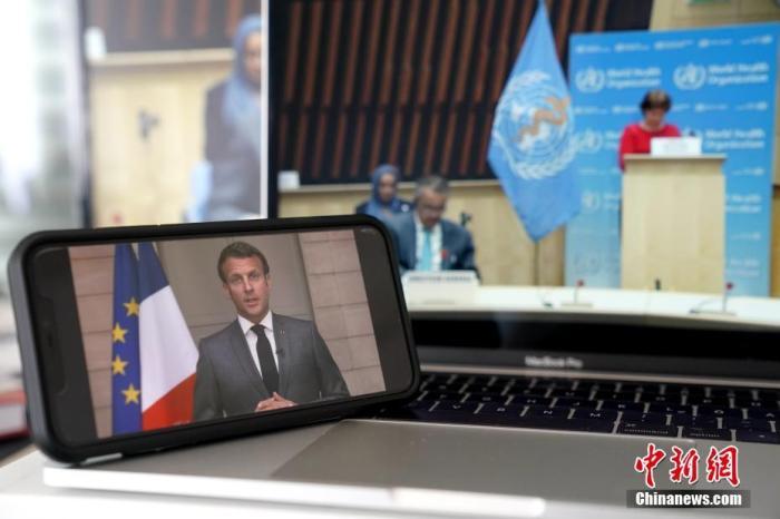 资料图:法国总统马克龙在世界卫生大会上远程致辞。记者 彭大伟 摄