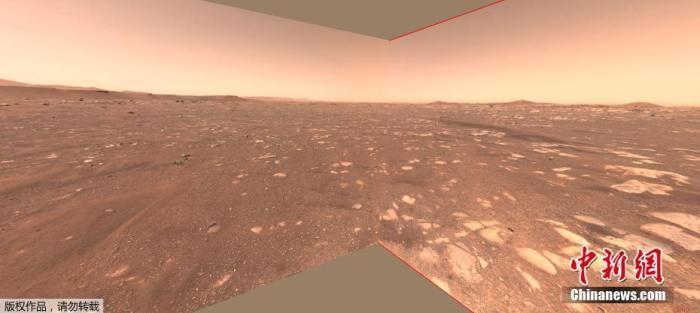 """资料图:NASA发布了一组概念图,演示了火星直升机""""机智号""""在火星飞行并着陆的画面,这将成为第一架尝试在另一个星球上进行动力控制飞行的飞机。"""
