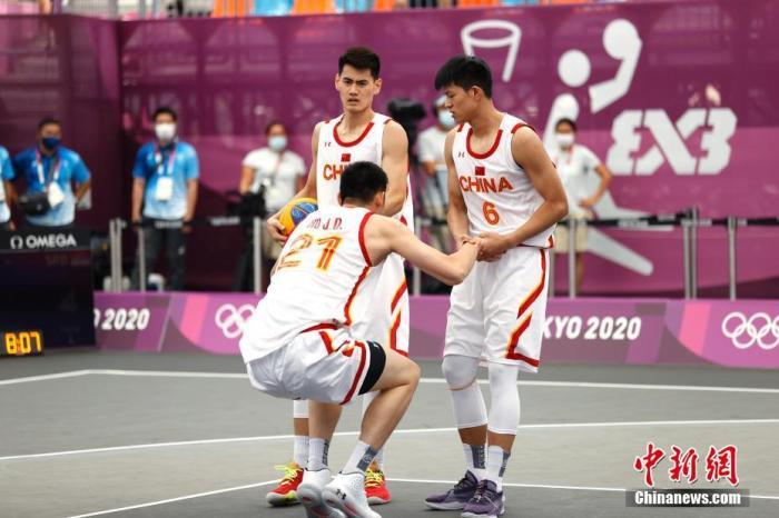 资料图:中国男子三人篮球队在比赛中。 中新社记者 富田 摄
