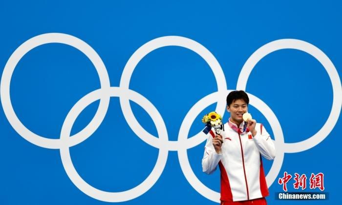 资料图:当地时间7月30日,东京奥运会男子200米混合泳决赛中,中国选手汪顺以1分55秒夺得冠军。中新社记者 富田 摄